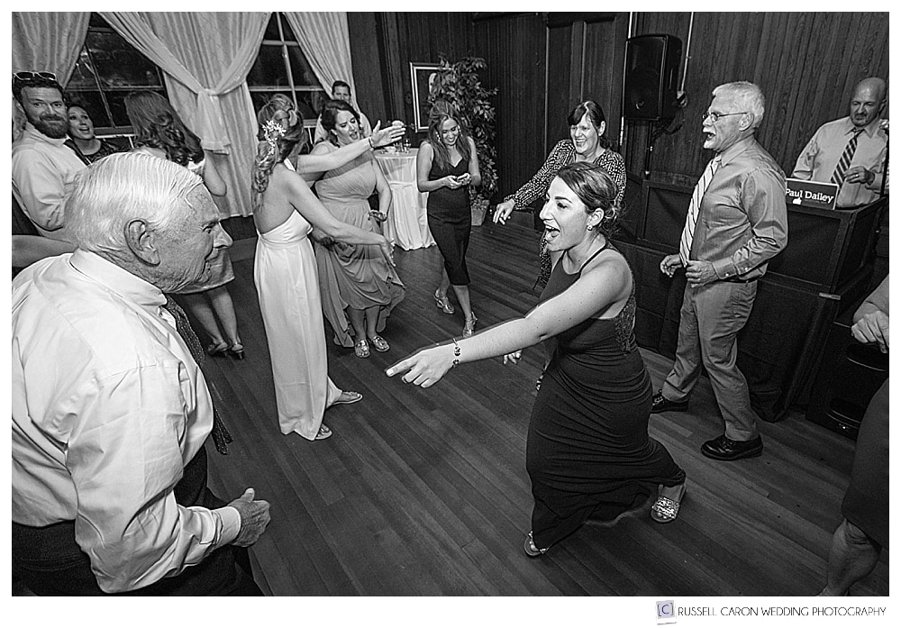 Black and white photo of guests dancing at a Lynch Park wedding reception