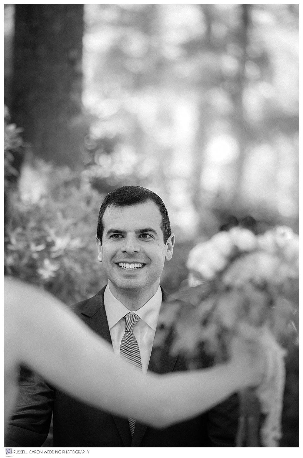 groom-walks-toward-bride-during-first-look