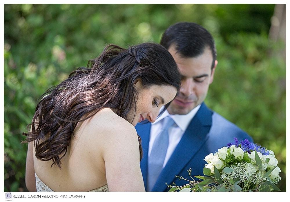 bride-shows-groom-her-wedding-dress