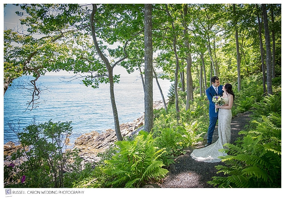 bride-and-groom-on-path-near-ocean