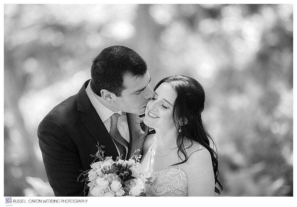 groom-kissing-bride-on-her-cheek