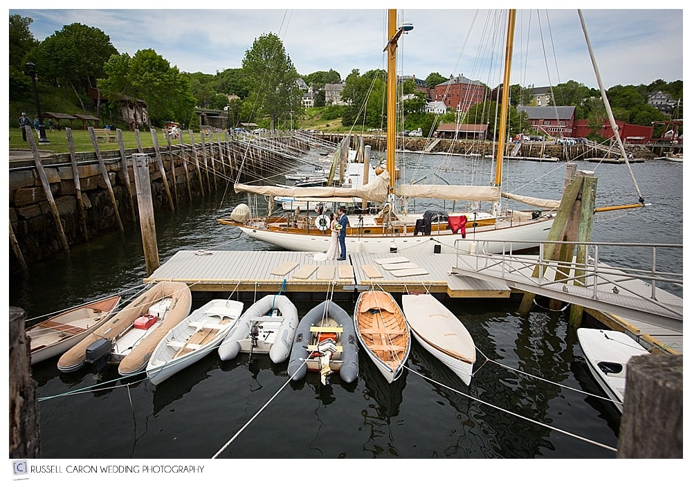 bride-and-groom-on-docks-in-rockport-maine-harbor