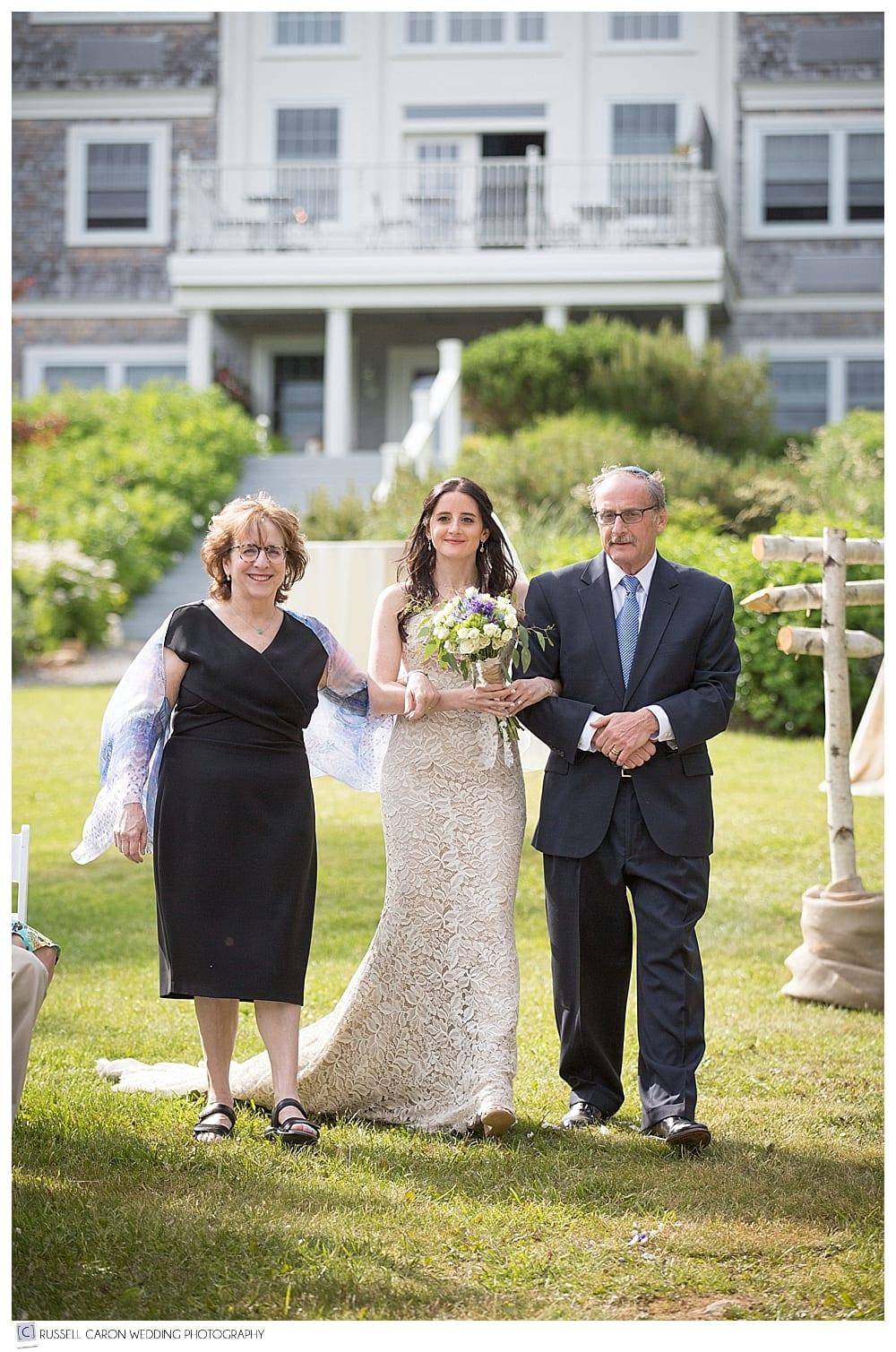 bride-and-parents-walk-down-the-aisle