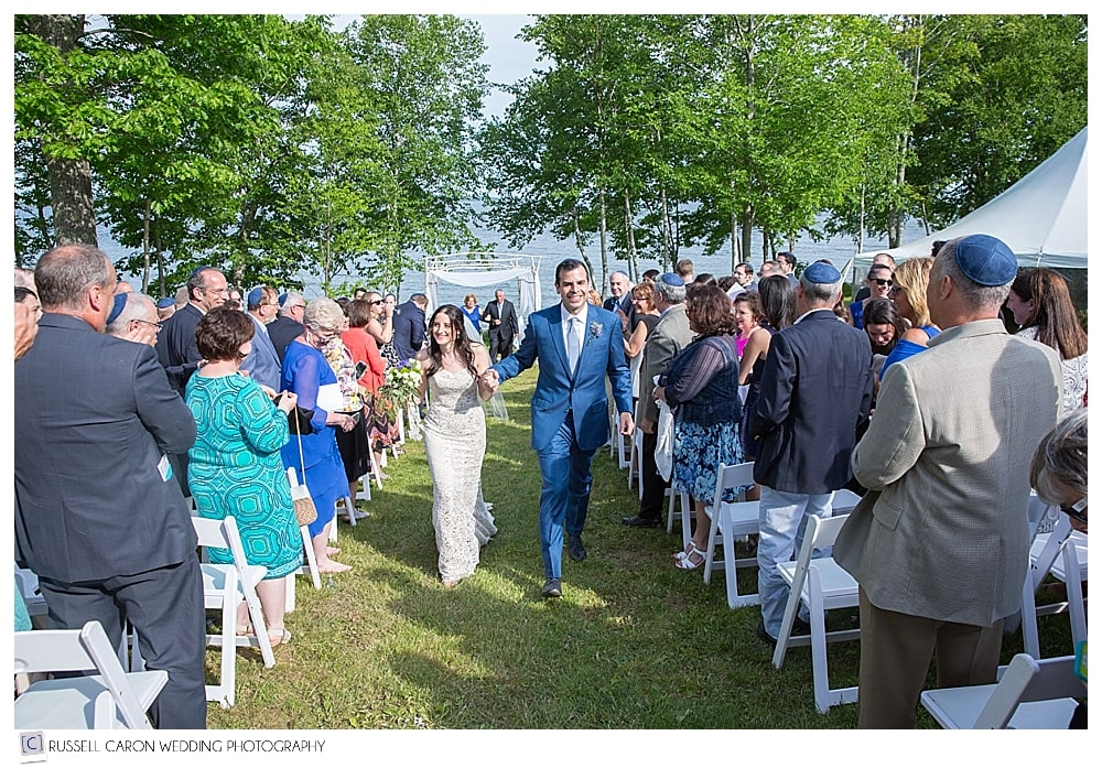 bride-and-groom-during-recessional-during-outdoor-ceremony