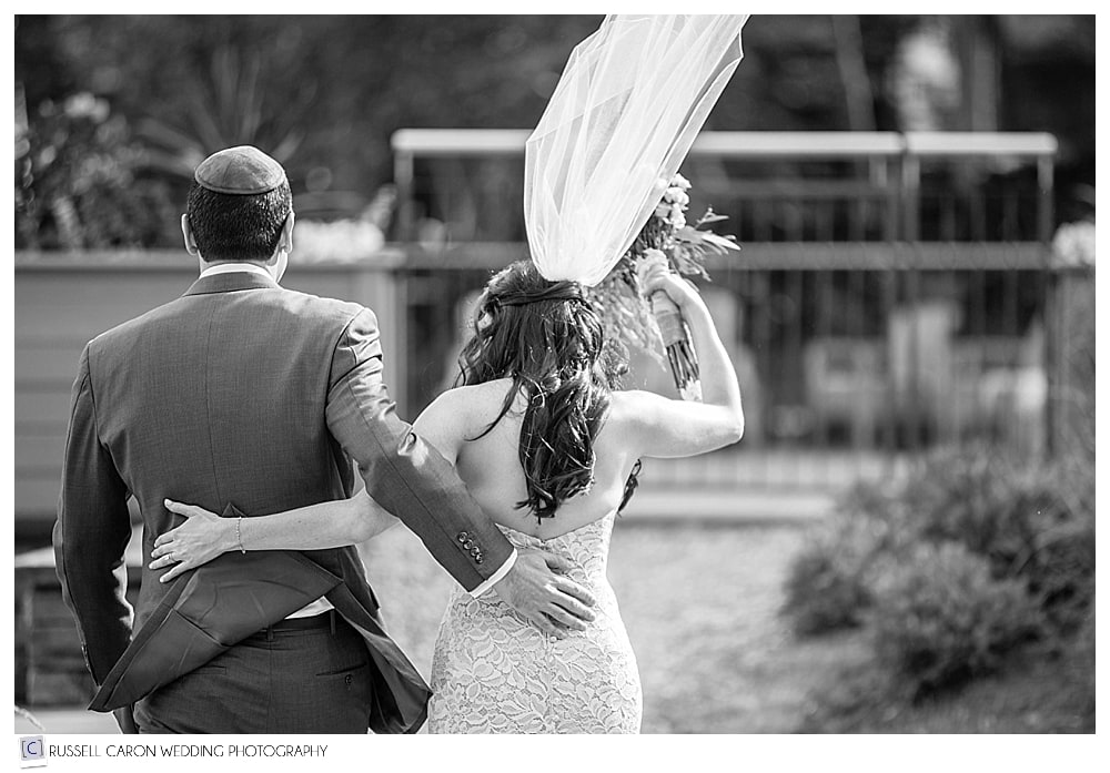 bride's-veil-blowing-during-recessional