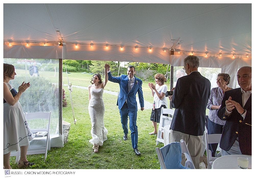 bride-and-groom-announced-into-tented-wedding-reception-at-inn-at-ocean's-edge-lincolnville-maine
