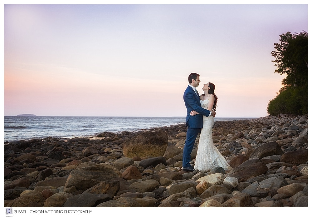 bride-and-groom-on-the-beach-at-inn-at-ocean's-edge-lincolnville-maine