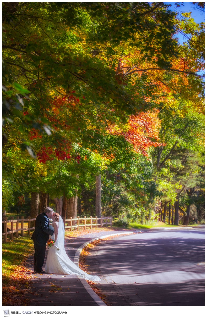 bride-and-groom-kissing-on-main-street-kennebunkport-maine