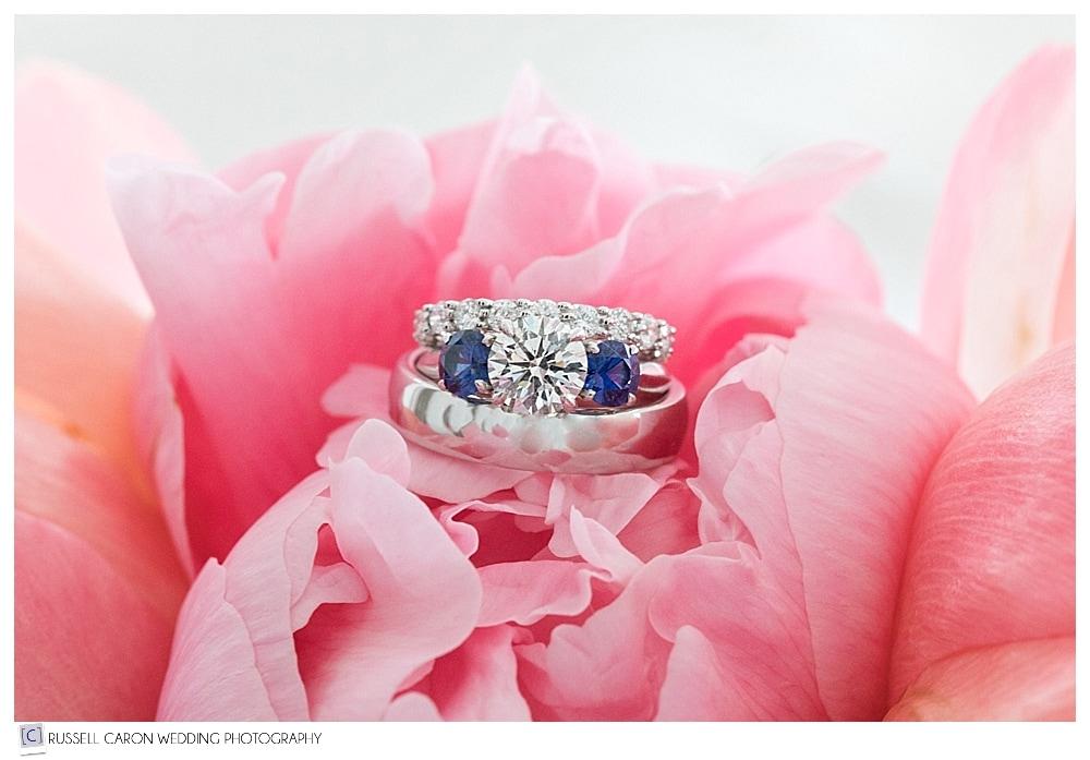 photo of wedding rings in flower