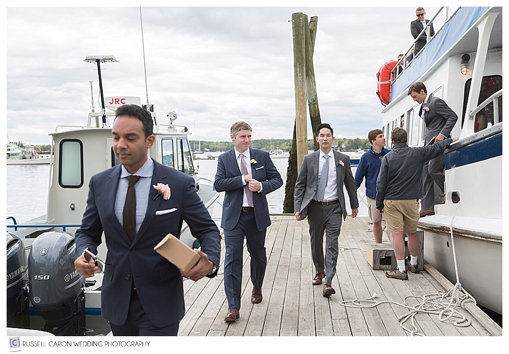 groom and groomsmen arriving on dock