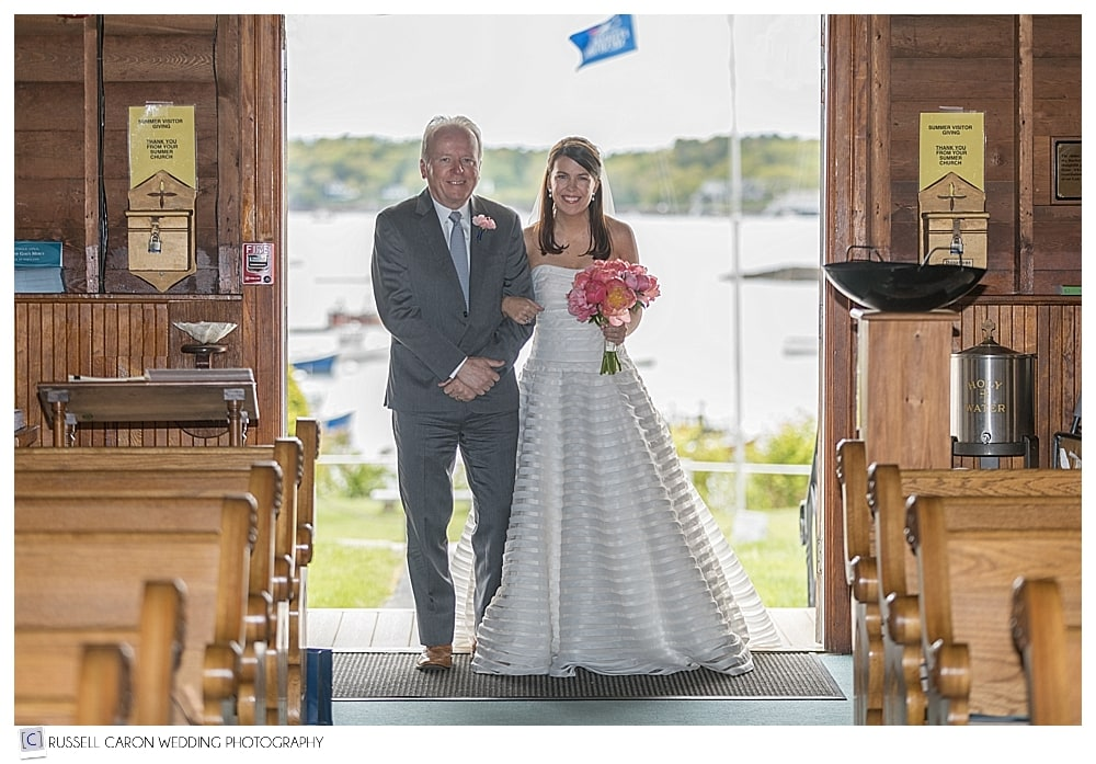 bride and her father in the doorway of Our Lady Queen of Peace Church
