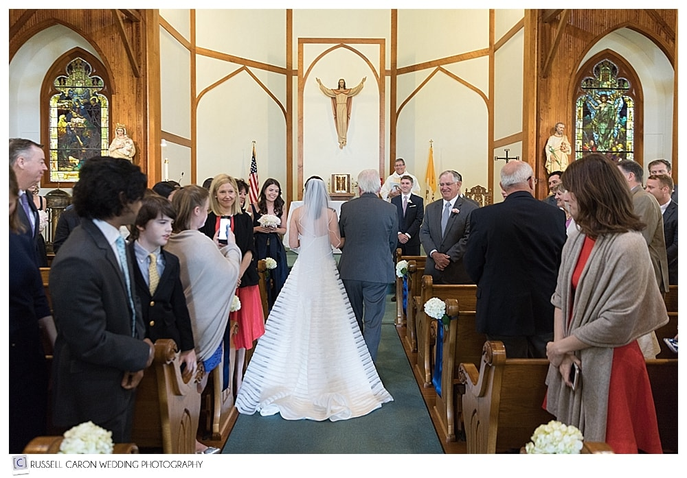 Bride and her father arriving at the altar of Our Lady Queen of Peace Church wedding