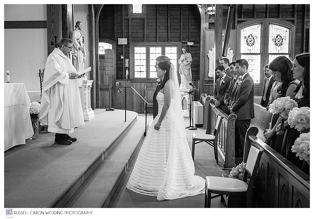 bride and groom during the blessing at Our Lady Queen of Peace Church