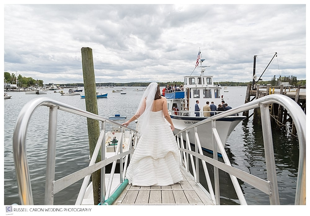 bride going down the gangway toward boat
