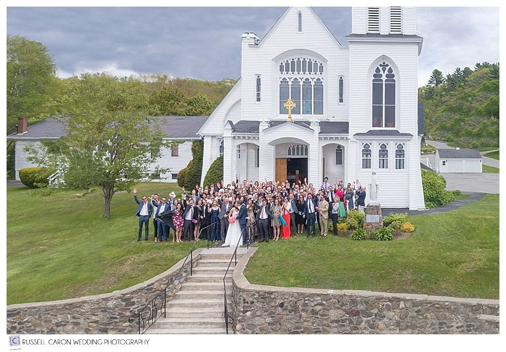 maine drone wedding photograph of wedding guests in front of Our Lady Queen of Peace Church