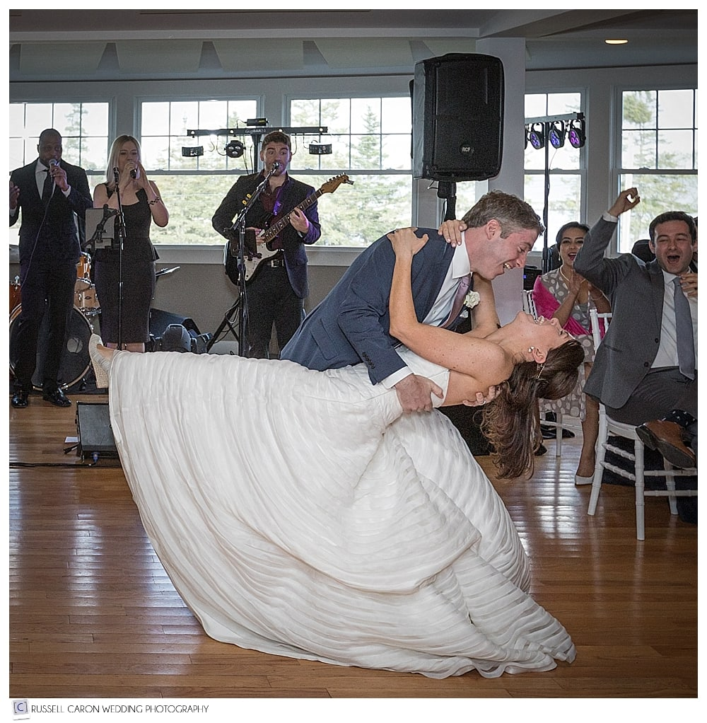 groom dipping the bride during first dance