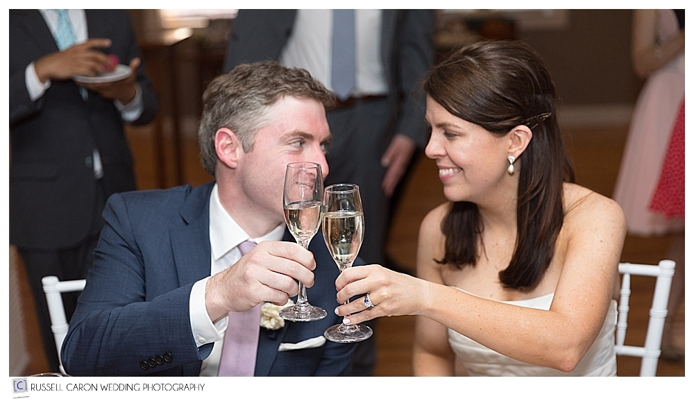 bride and groom during champagne toast