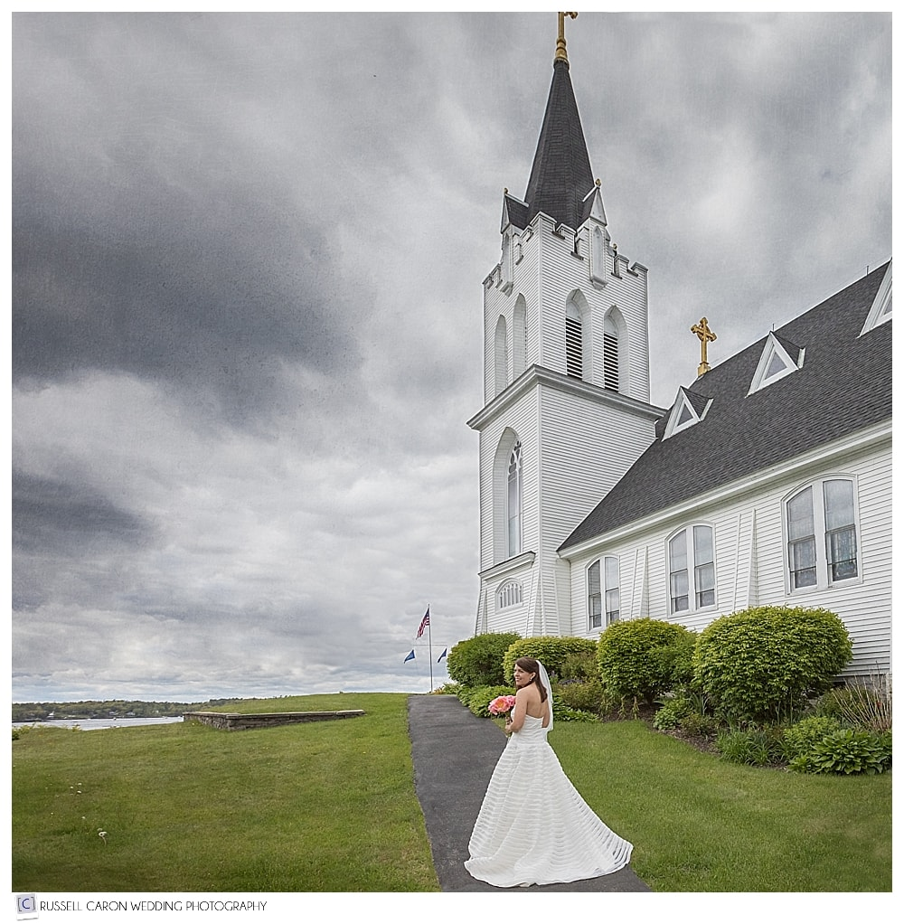 bride walking towards Our Lady Queen of Peace Church in Boothbay Harbor Maine