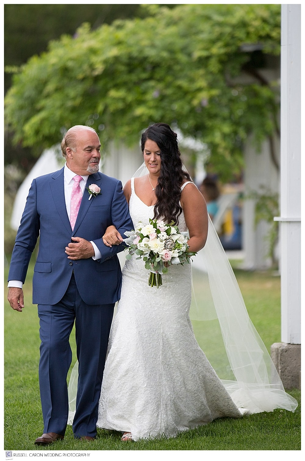 bride and father coming down the aisle