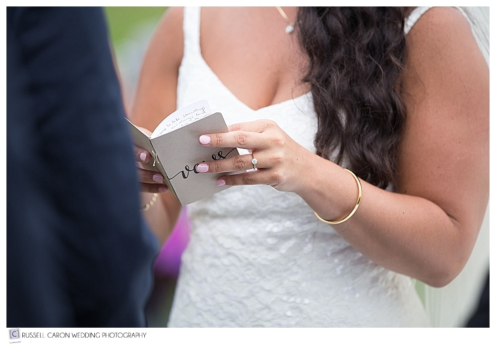 bride holding book of vows
