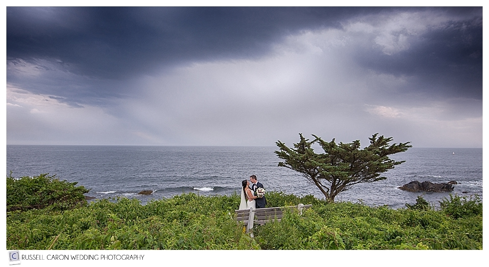 bride and groom with stormy skies