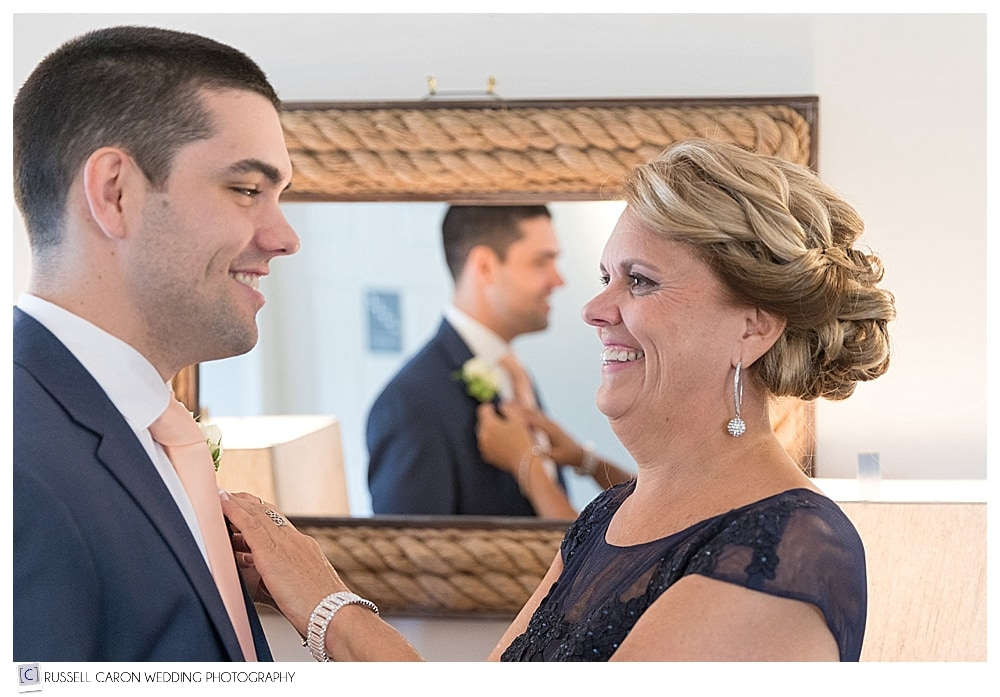 mother prepping son for wedding