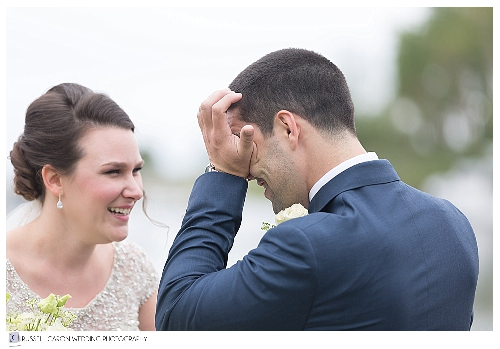 groom wiping tear during wedding day first look