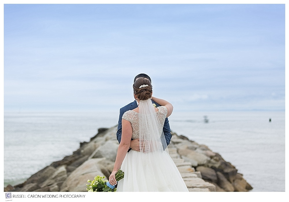 bride and groom on Kennebunkport, Maine breakwater