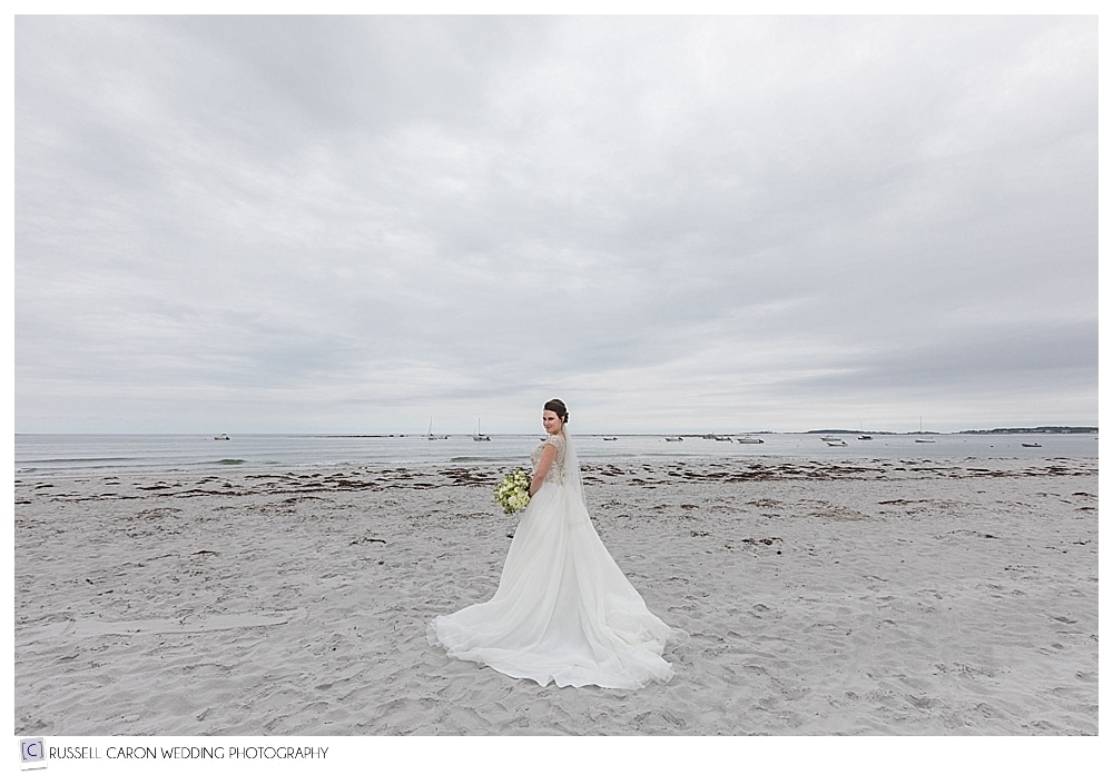 bride standing on goose rocks beach maine