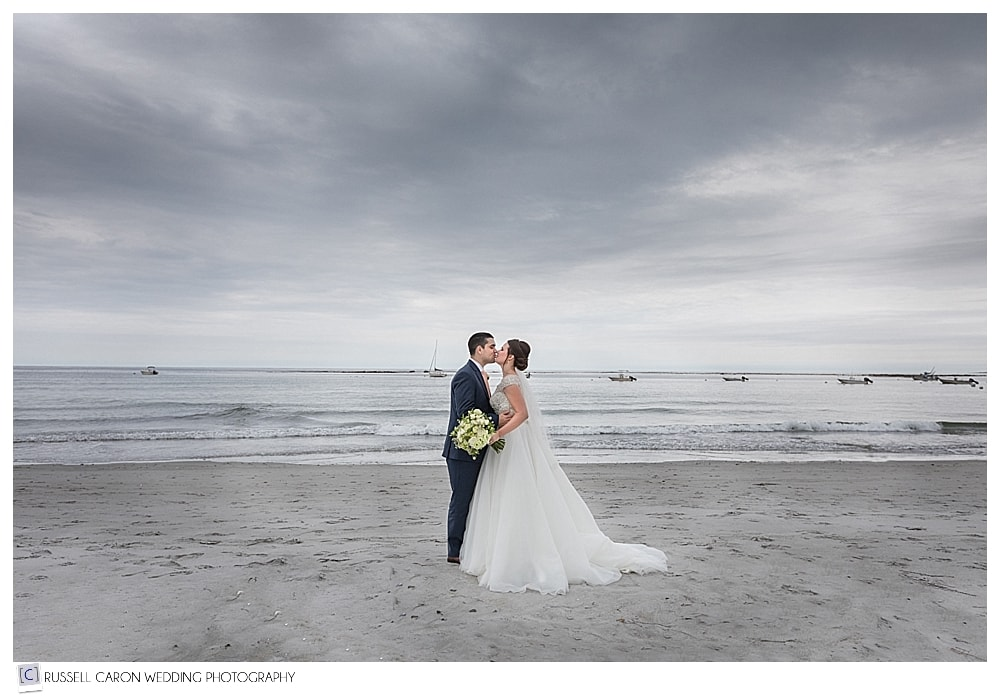 bride and groom kissing on goose rocks beach, kennebunkport maine