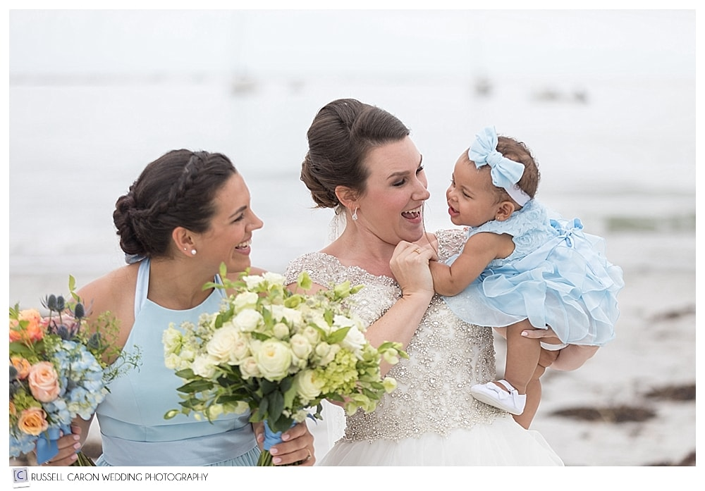 bride holding baby