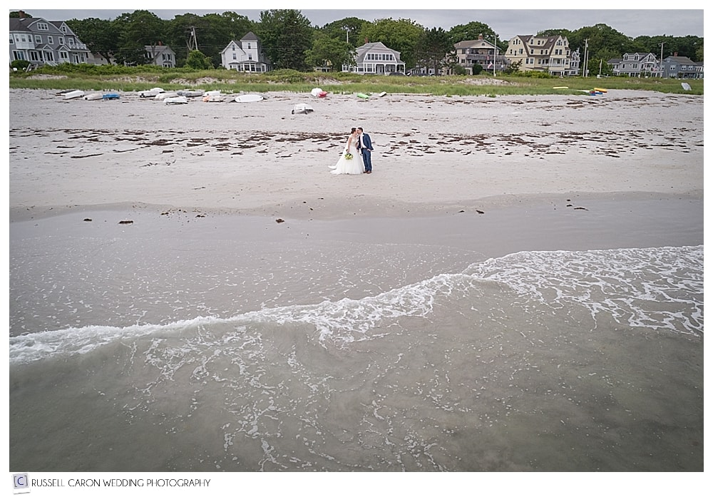 bride and groom on Goose Rocks Beach with maine wedding drone