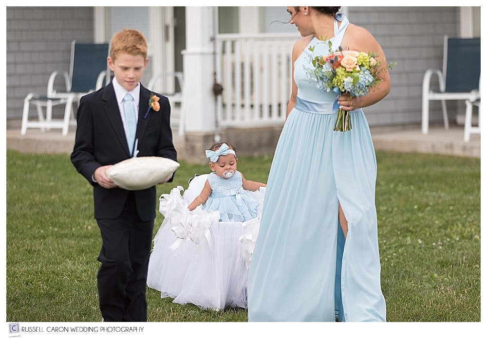bridesmaid pulling wagon with baby