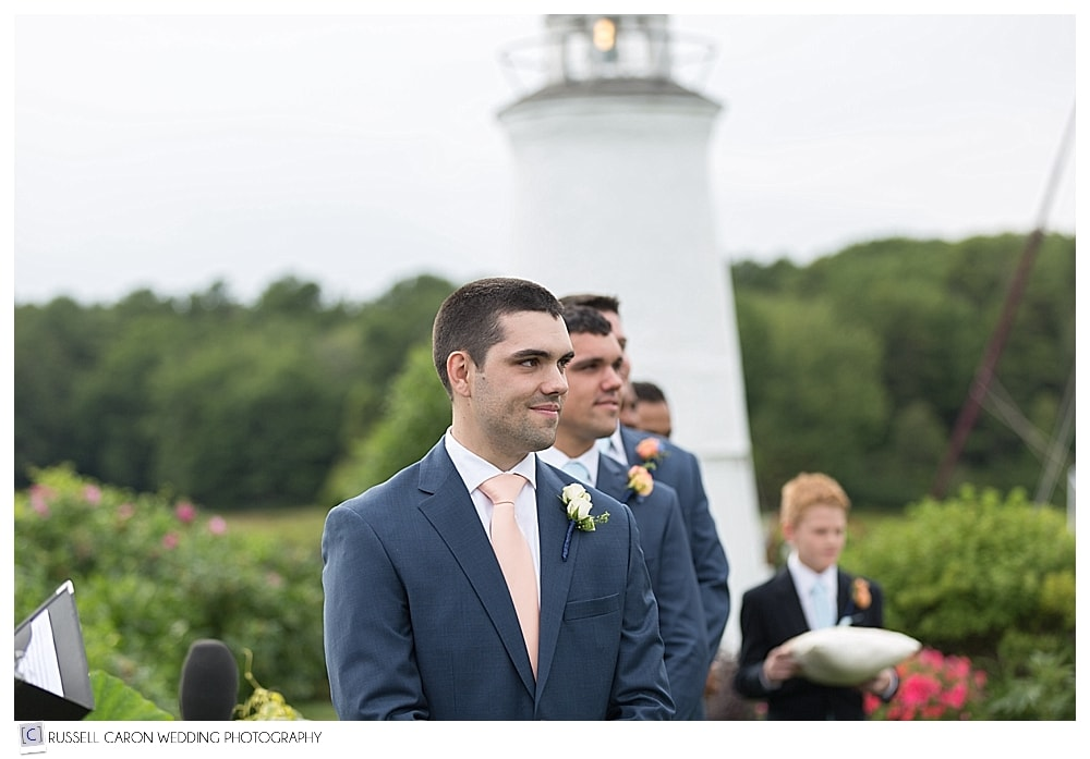 groom watching his bride walk down the aisle at the Nonantum Resort, Kennebunkport, Maine