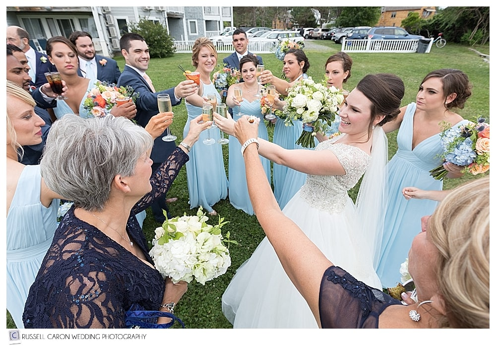 bridal party having a champagne toast
