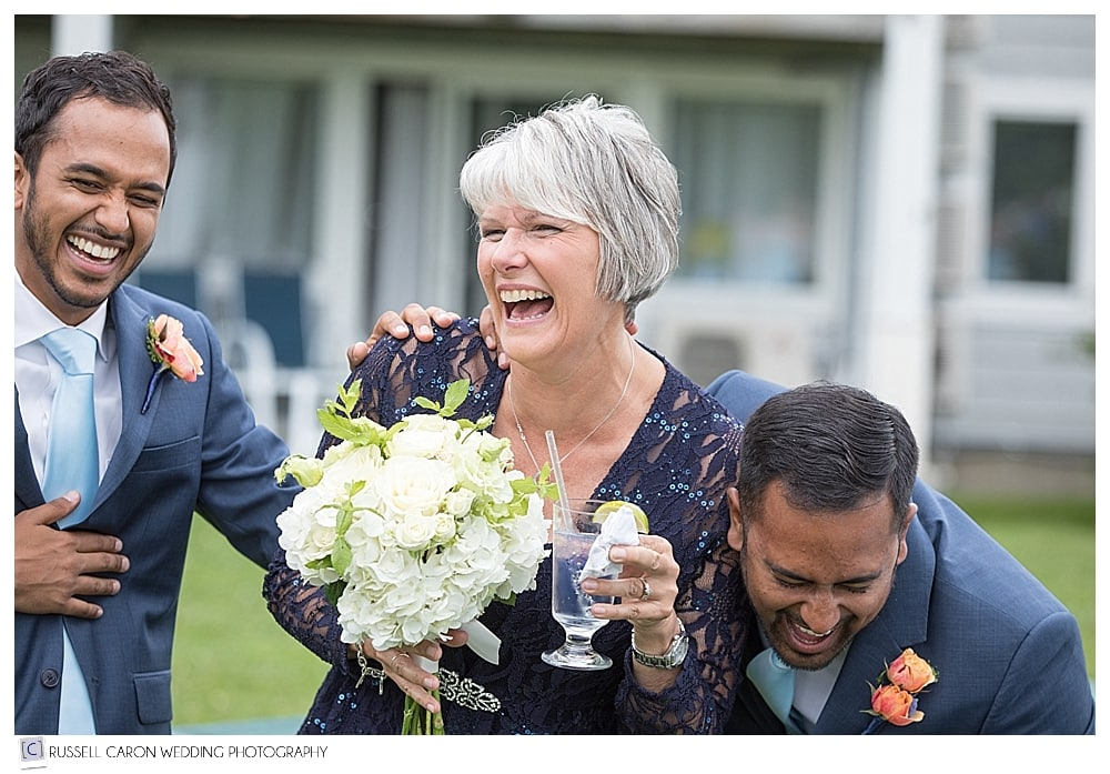 guests laughing at cocktail reception