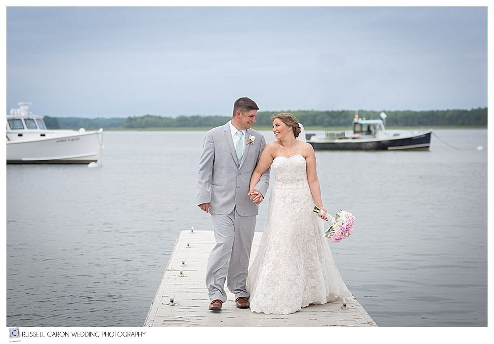 bride and broom walking on dock