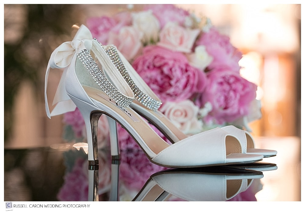 bride's wedding shoes and bouquet
