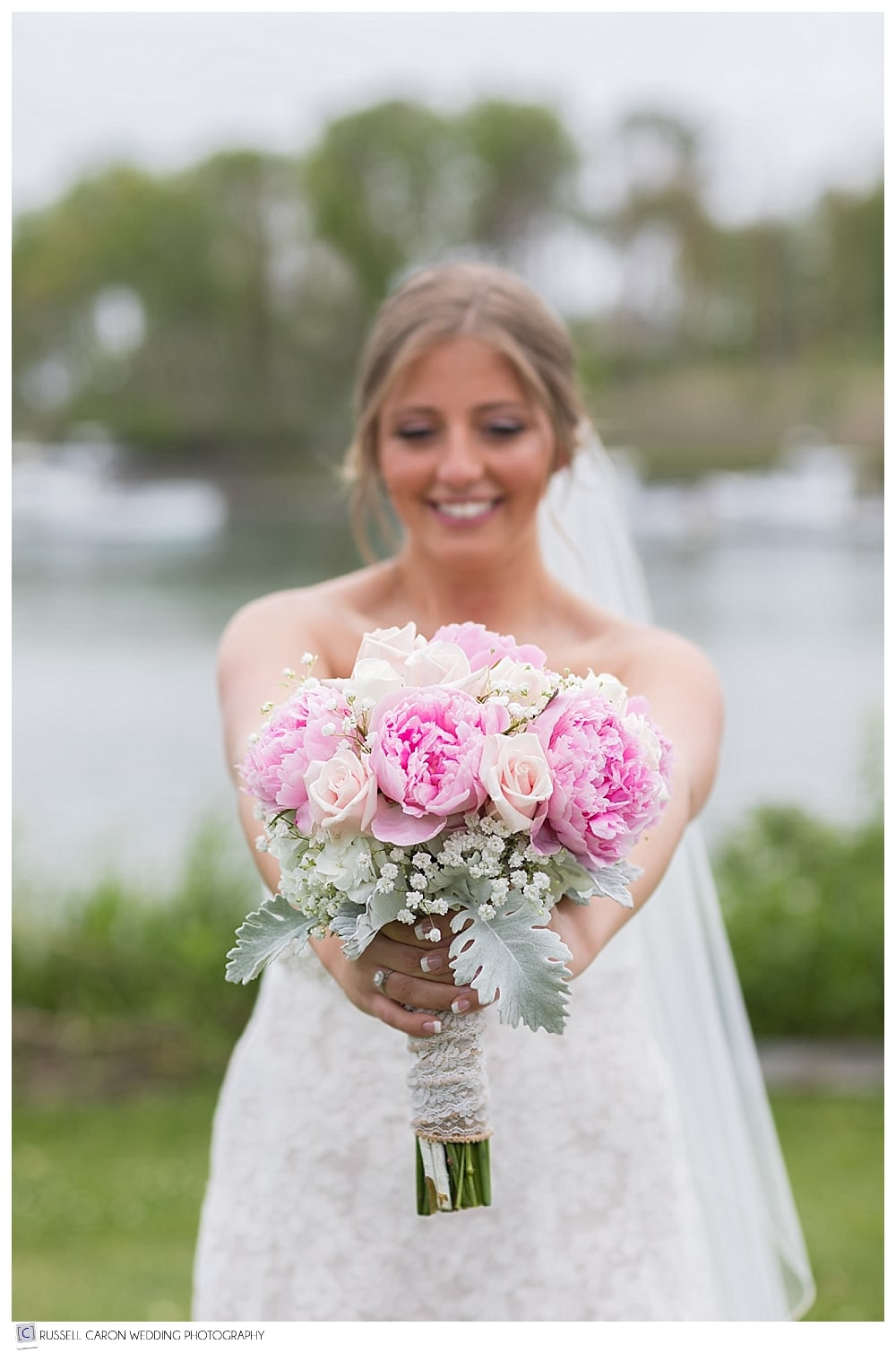 Bride holding out wedding bouquet