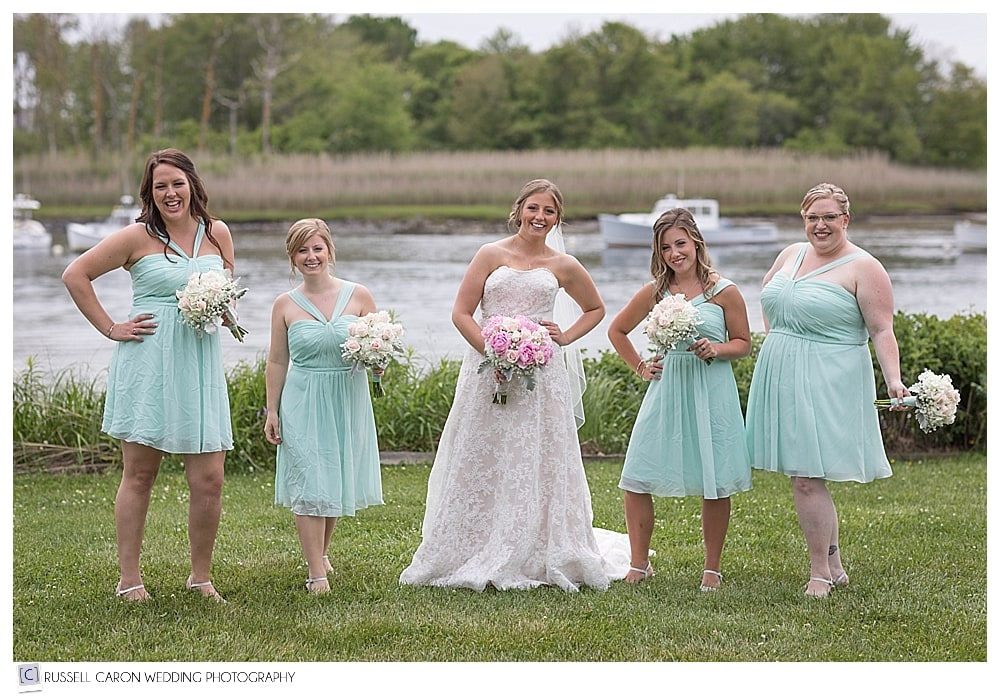 Bride and bridesmaids on the lawn at the Nonantum Resort, Kennebunkport Maine