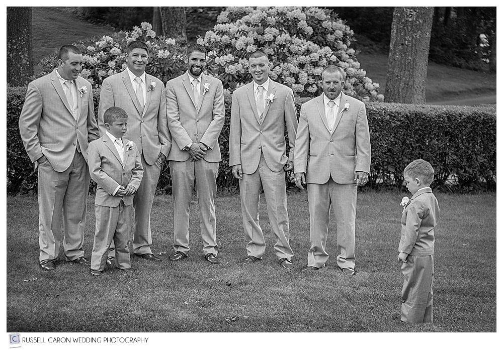 Groom and groomsmen with Ring Bearer pouting