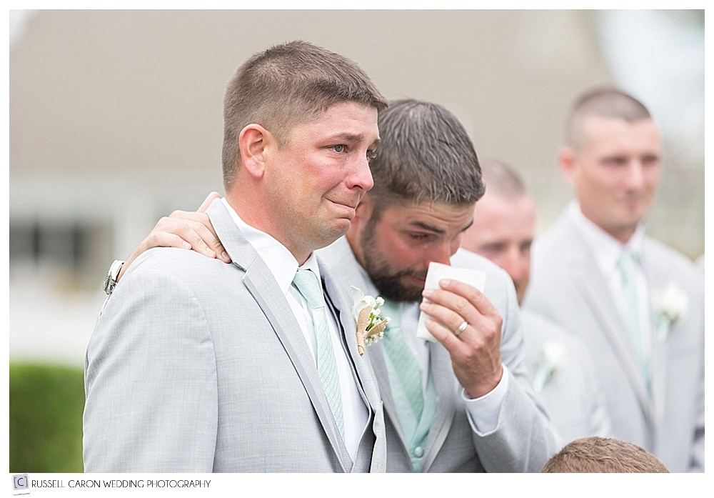 Emotional groom and groomsman