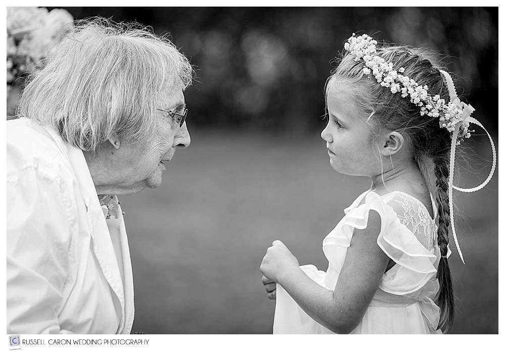 Grandmother talks to Flower Girl