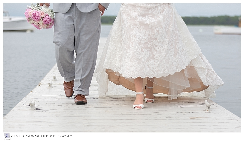 bride and groom's feet as they walk on dock