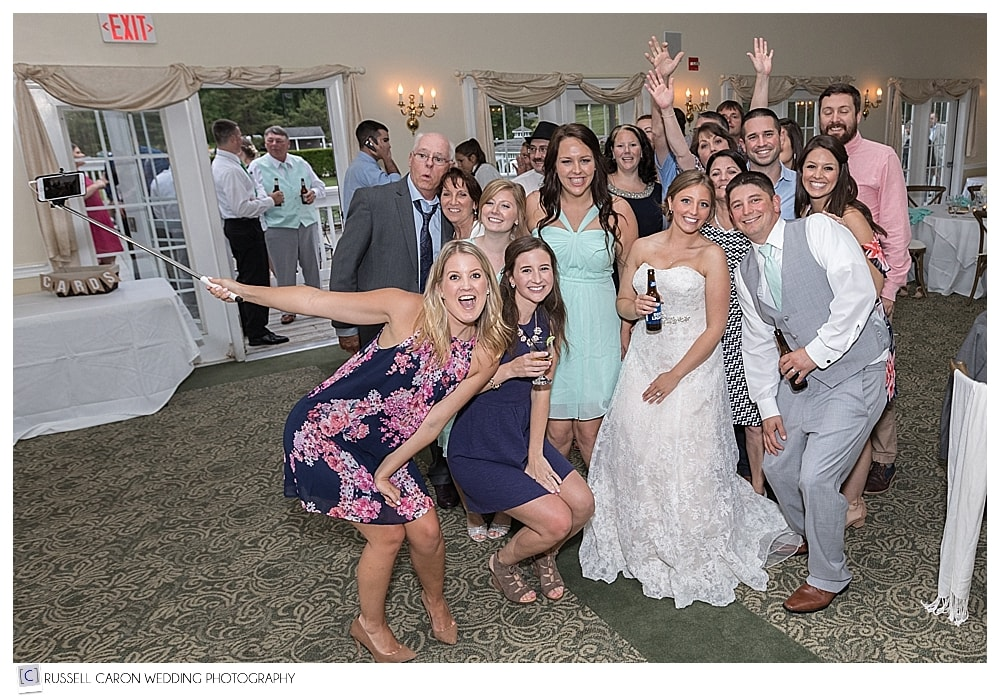bride and groom and friends with selfie stick