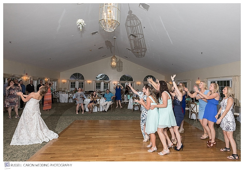 bride tosses her bouquet