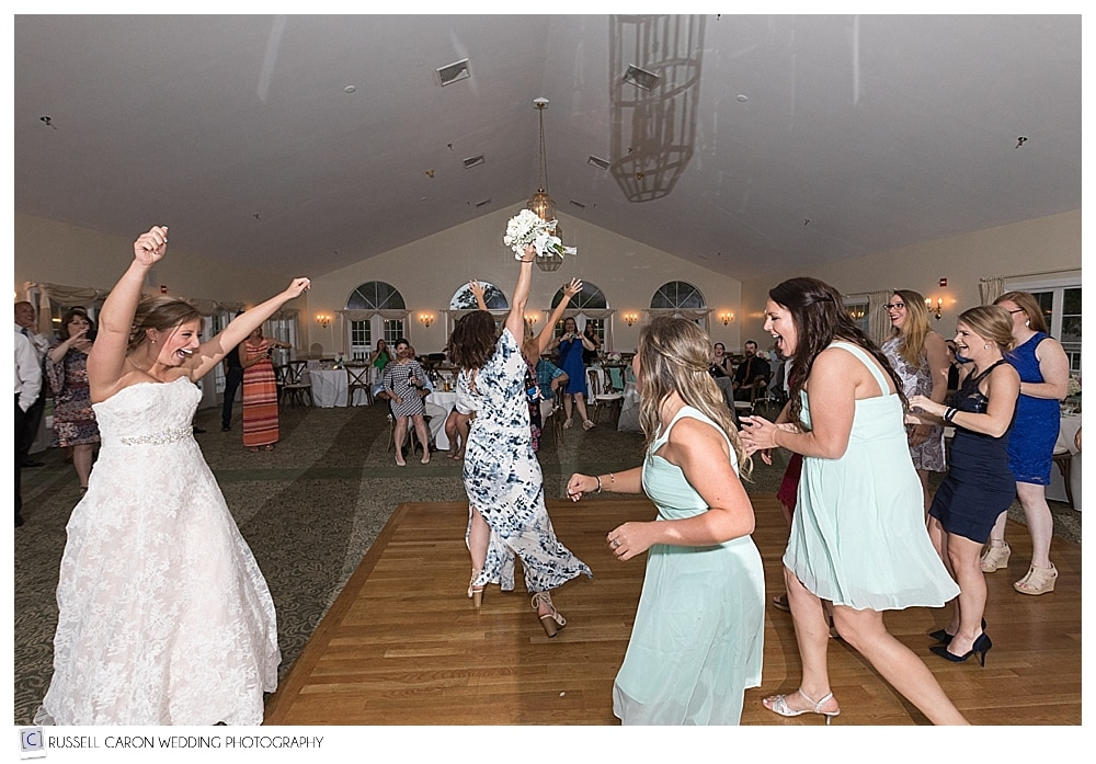 woman catches bride's bouquet