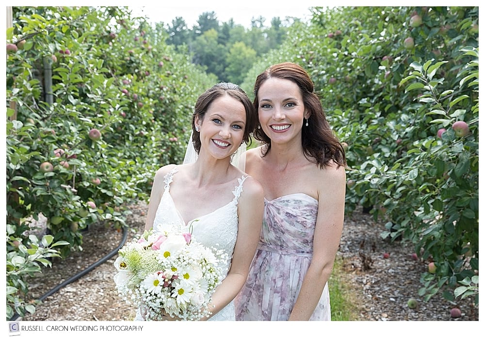 Bride with sister in Parlee Farms apple orchard