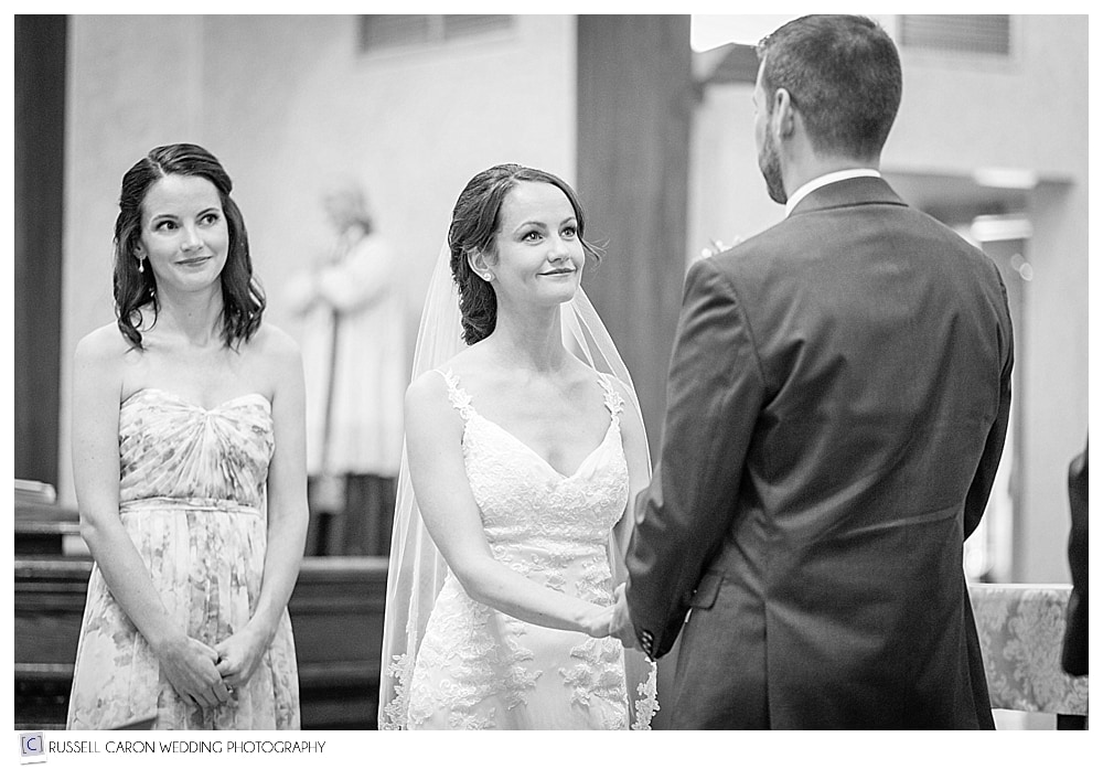 Bride looking at groom during wedding ceremony at St. Kathryn's Church