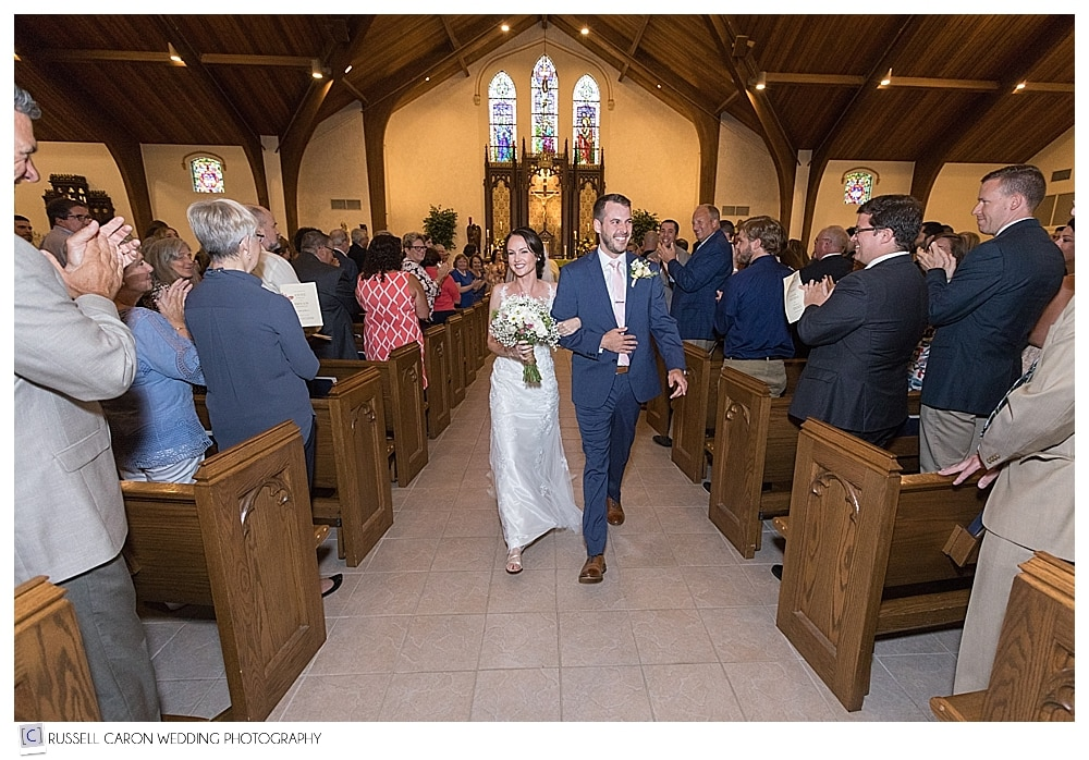 bride and groom during wedding recessional